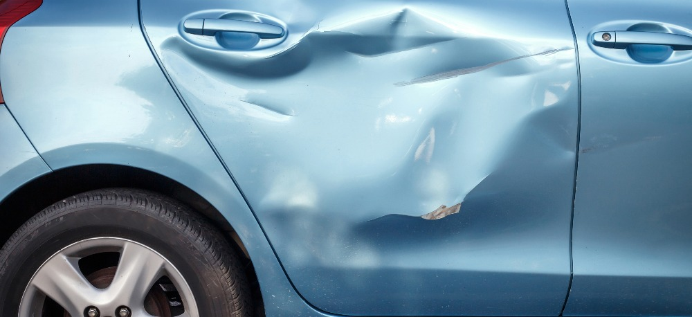 Blue car with damaged frame