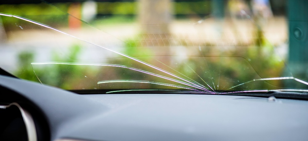 Cracked windshield that could get a ticket in Illinois.